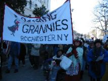 The Rocherster, NY Raging Grannies march and sing.