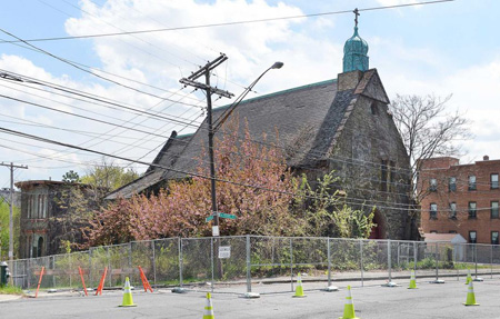 The long-shuttered former Church of the Holy Innocents in Arbor Hill is fenced off after part of it collapsed Monday on N. Pearl Street Tuesday May 5, 2015 in Albany, NY. (John Carl D'Annibale / Times Union)